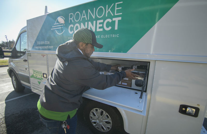Roanoke Connect employee retrieving supplies from service van