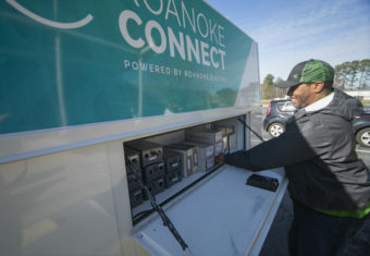 Roanoke connect seviceman getting equipment from truck