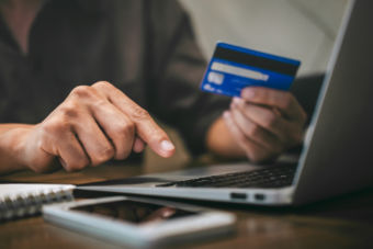 Businessman holding credit card and typing on laptop for online shopping and payment makes a purchase on the Internet, Online payment, Business financial and technology.
