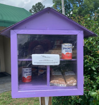 purple box outside with food donations inside