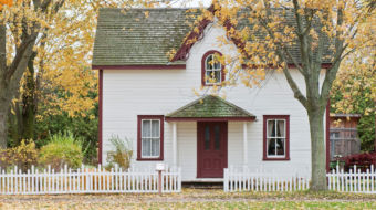 house with leaves on ground