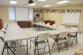 multipurpose room with tables, chairs, and mounted tv