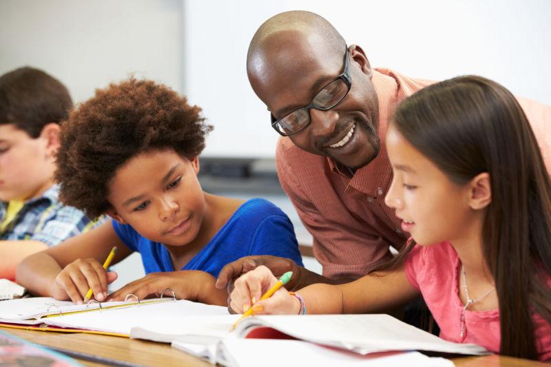 Man teachings young kids in classroom