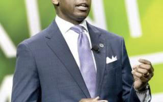 bottom half of face and chest of African American male in a blue suit